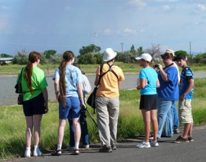 Task force members showing the marsh to Julia Dendinger