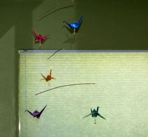 mobile of origami cranes folded by Valerie Ford